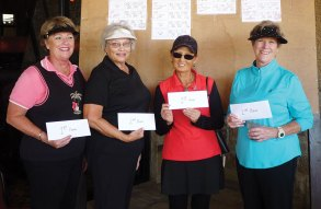 First flight winners from left to right: Nancy Freisheim, Pat Sands, Ok Cha Cummings, Diane Brent
