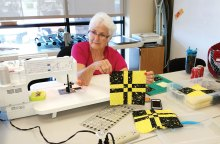 Dottie Welsh constructing the Disappearing 4-Patch Block; photo by Sue Price.