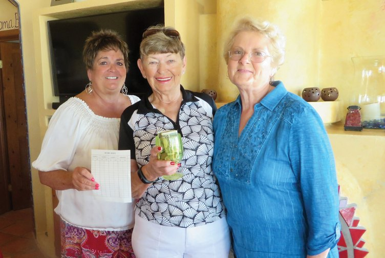 From left to right: Babs Barney, Margaret Erickson, Laurie Waluk. Babs presenting awards to winners for the bridge play.