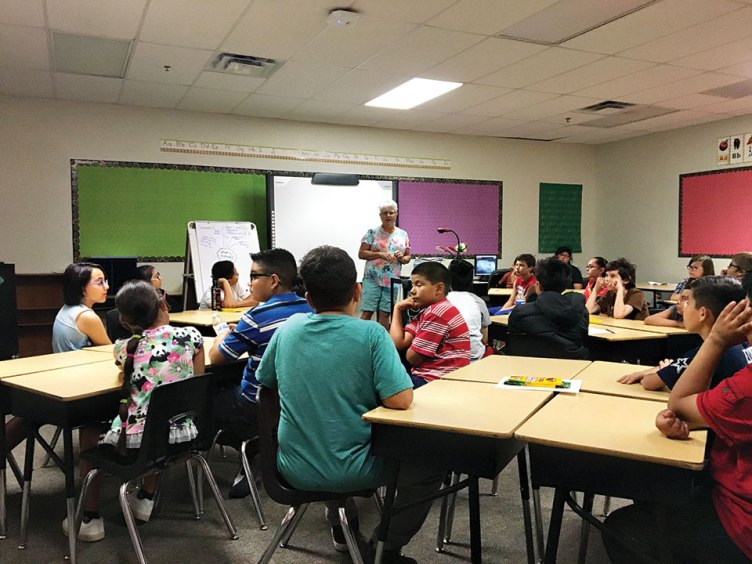 Nancy Friedman presenting the video and other information to students at the Desert Willow Elementary School