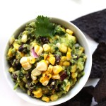 Grilled Corn and Black Bean Guacamole. Smoky, sweet corn and meat-y black beans. Perfect for summertime. Only requires 8 ingredients. #vegan #glutenfree #guacamole