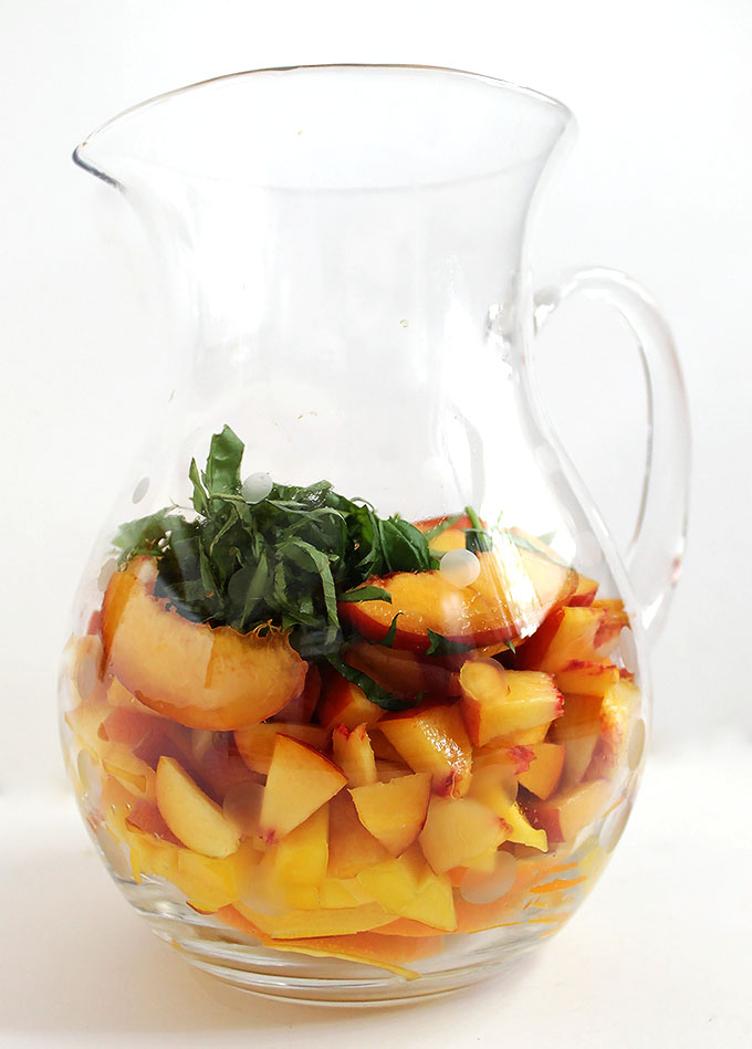 Peach Mango Sangria. Peach-y, mango-y, refreshing. #sangria #summercocktail #refinedsugarfree | robustrecipes.com