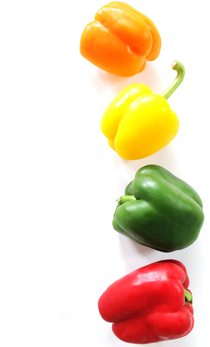 Colorful bell peppers for Greek Quinoa Stuffed Peppers. #glutenfree #recipe | robustrecipes.com