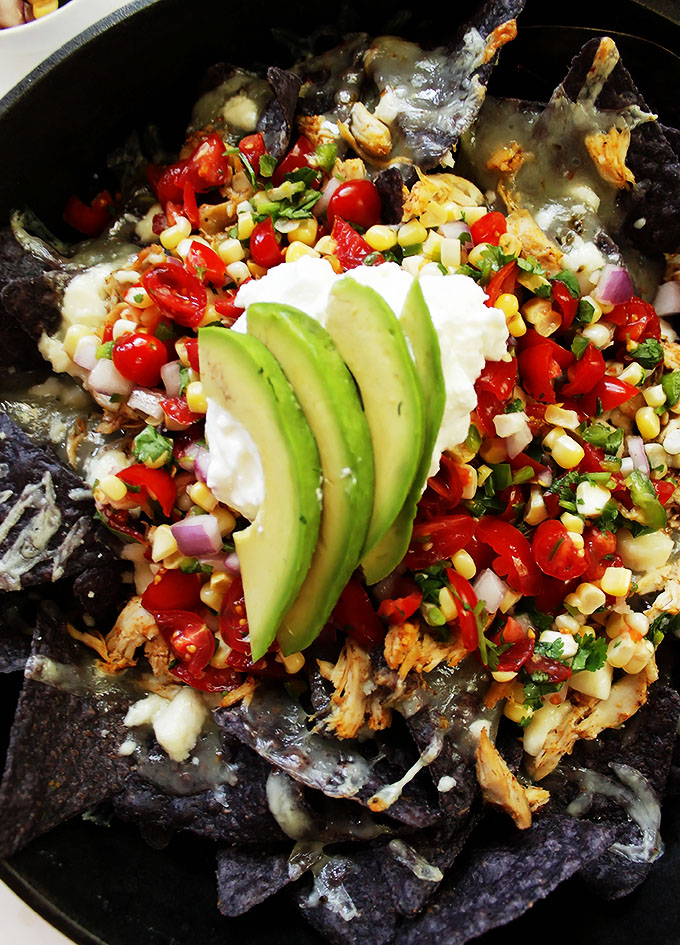 Shredded chicken nachos with corn pico de gallo. Use slow cooker pulled chicken. Super easy to make. #glutenfree #nachos | robustrecipes.com