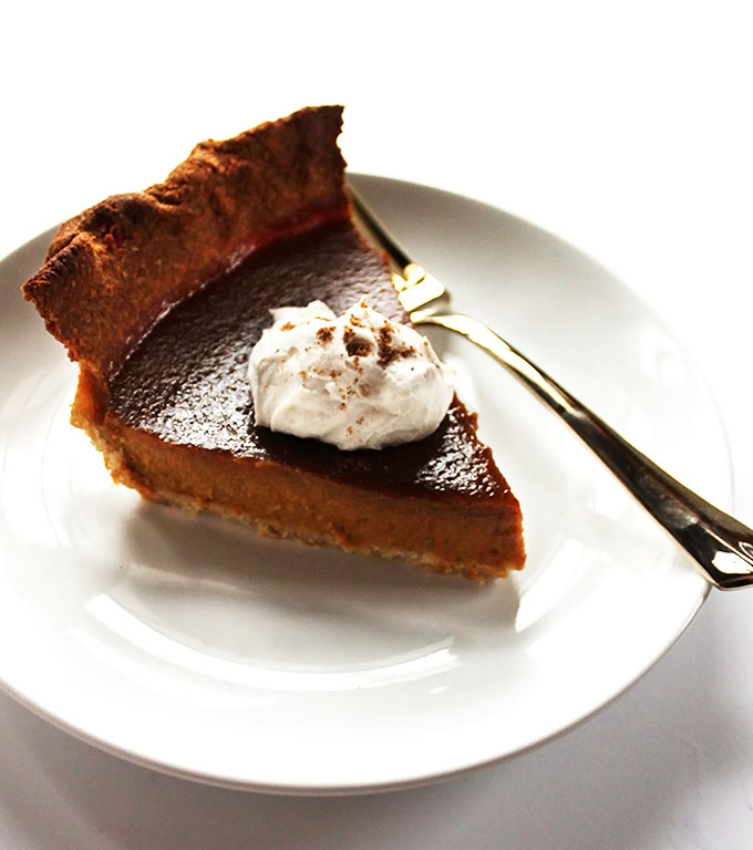 Gluten Free Pumpkin Pie! Crust made with coconut flakes and oat flour. Creamy, smooth pumpkin pie filling. Perfect for fall time.