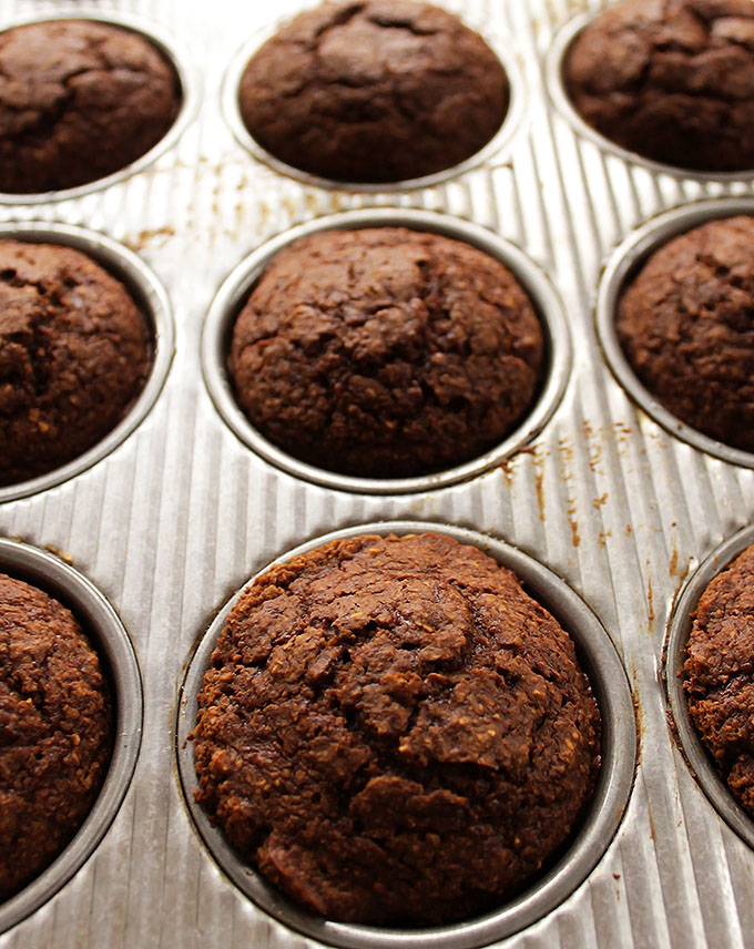 Gluten Free Gingerbread Pear Muffins. Made with oat flour. Loaded with rich molasses, spicy ginger, and fresh sweet pear.