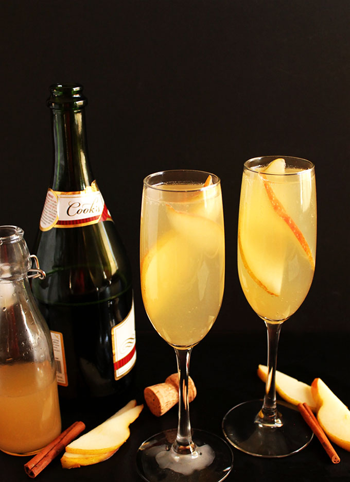 Pear Mimosa. So easy to make. Sweet pear with a hint of warming cinnamon, mixed with bubbly champagne! Perfect for any cocktail celebration party!
