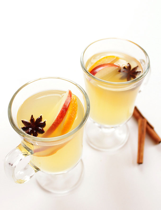 Mulled White Wine - A warm white wine infused with apples. pears. oranges, and warming spices. Such an EASY recipe to make! We LOVE this cocktail in the winter! | Robustrecipes.com