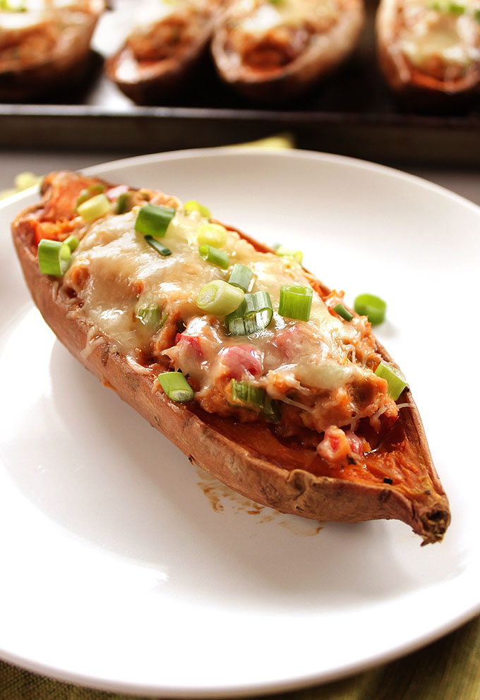Sweet Potato Salmon Melts - Baked Sweet potatoes stuffed with creamy salmon salad and topped with melted cheese! An EASY recipe that's perfect for any weeknight meal. So nutritious! Gluten Free | robustrecipes.com