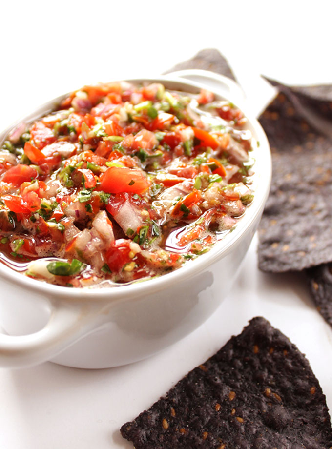 Grape Tomato Salsa - EASY Fresh salsa made in only a few minutes. Simple, whole food ingredients: grape tomatoes, garlic, red onion, cilantro, lime juice, jalapeno! SO TASTY! Vegan/Gluten Free. | robustrecipes.com