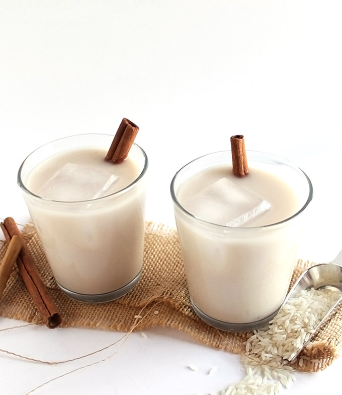 Naturally Sweetened Horchata - Toasted rice, almonds, and cinnamon sticks blend into a creamy dreamy cinnamon drink. Naturally sweetened with agave nectar. EASY to make! Gluten Free/Vegan/Dairy Free. | robustrecipes.com
