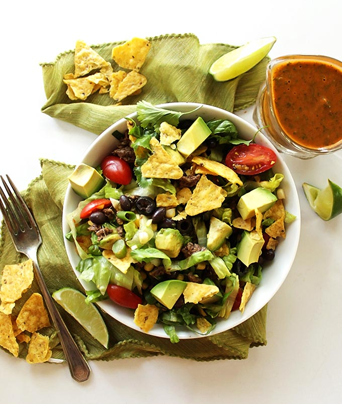 Healthy Taco Salad - Crisp, shredded romaine lettuce piled high with favorite taco toppings. This easy recipe is perfect for summer! Gluten Free