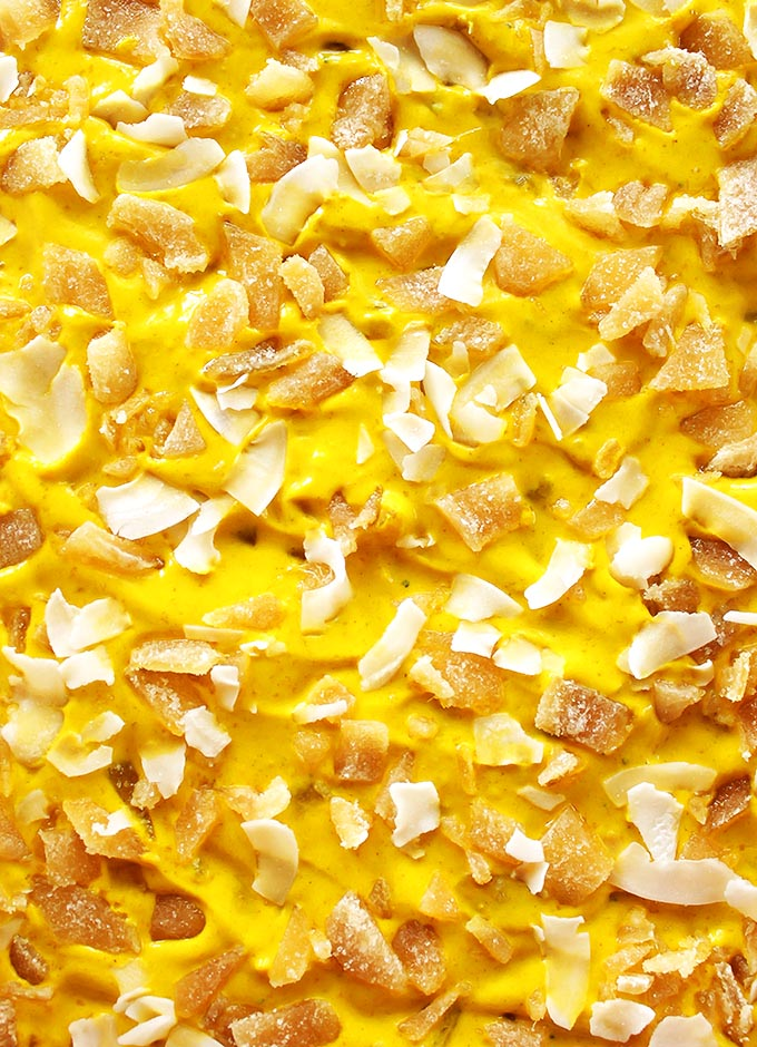 Golden Milk Frozen Yogurt Bark - Inspired by golden milk, this bark is packed with healthy turmeric. It's cold, creamy, nutty, with warming spices and crystallized ginger. This recipe is EASY to make! Perfect for a summer snack. Gluten Free.
