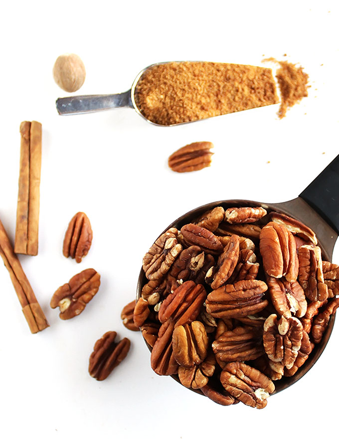 5 Minute Spiced Pecans - Crunchy, sweet, slightly spicy. This recipe is super EASY to make, only requires 7 ingredients! They're the perfect snack, or to add to salads, yogurt, oatmeal. They also make a great edible gift! Vegan/gluten free/refined sugar free | robustrecipes.com