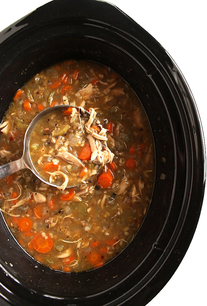 Slow Cooker Chicken and Wilde Rice Soup - This recipe is EASY to make, only requires 8 ingredients and 10 minutes to prep! It's great for when you're sick. Plus it makes a large batch and freezes well. Gluten Free/Dairy Free | robustrecipes.com