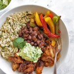 Chicken Fajita Bowls with Cilantro Lime Rice - Bowls with all of the BEST fajita fixings: chicken, black beans, sauteed peppers and onions, guacamole and cilantro lime rice! This recipe is healthy and packed with flavor! Gluten Free/Dairy Free   robustrecipes.com