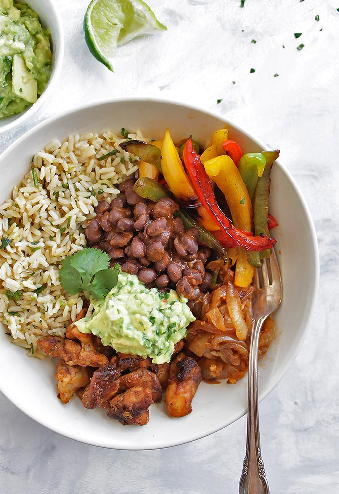 Chicken Fajita Bowls with Cilantro Lime Rice - Bowls with all of the BEST fajita fixings: chicken, black beans, sauteed peppers and onions, guacamole and cilantro lime rice! This recipe is healthy and packed with flavor! Gluten Free/Dairy Free | robustrecipes.com