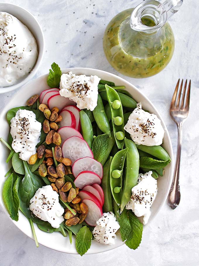 Simple Spring Salad with Sugar Snap Peas and Burrata - only takes 10 minutes to make! Fresh veggies drizzled with a lemon herb vinaigrette! Perfect recipe for a side or appetizer to any meal! Vegetarian/Gluten Free | robustrecipes.com