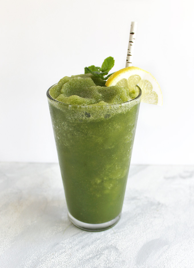 Basil Mint Lemon Slushie - A healthy and super refreshing slushie made using fresh basil, mint, and lemon. Perfect for hot summer days. Makes a delicious healthy dessert. This recipe only requires 10 minutes to make, a handful of ingredients, and a blender! Vegan/Gluten Free/ Refined Sugar free | robustrecipes.com