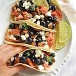 Salmon Tacos with Blueberry Almond Salsa - filled with pan seared salmon and a juicy blueberry almond salsa. The combo will surprise you. This recipe is simple enough for a weeknight meal (only takes 20 minutes to make), but special enough for a weekend meal. Perfect for summer! Gluten Free | robustrecipes.com
