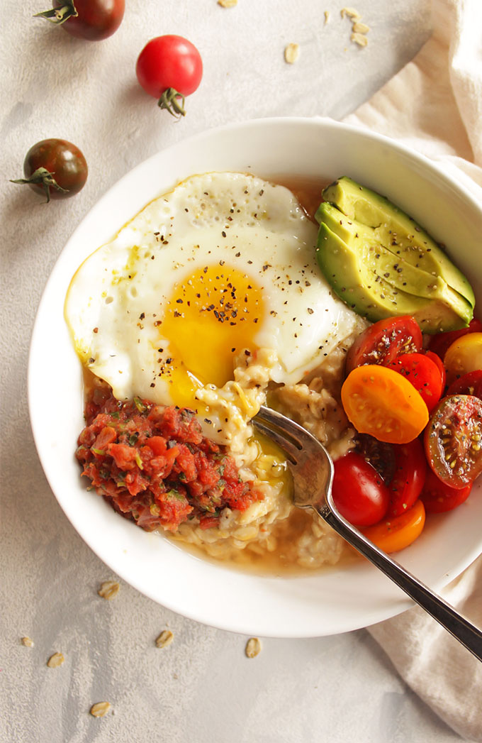 12 Minute Savory Oatmeal with Fried Eggs - A quick and easy breakfast that is perfect for weekday mornings. This savory oatmeal recipe is packed with protein, healthy carbs, fiber, healthy fats, and nutrition from the tomatoes. It will keep you fueled and satisfied until lunch. One of my favorite weekday breakfasts during the fall and winter. (Gluten Free and Vegetarian). | robustrecipes.com