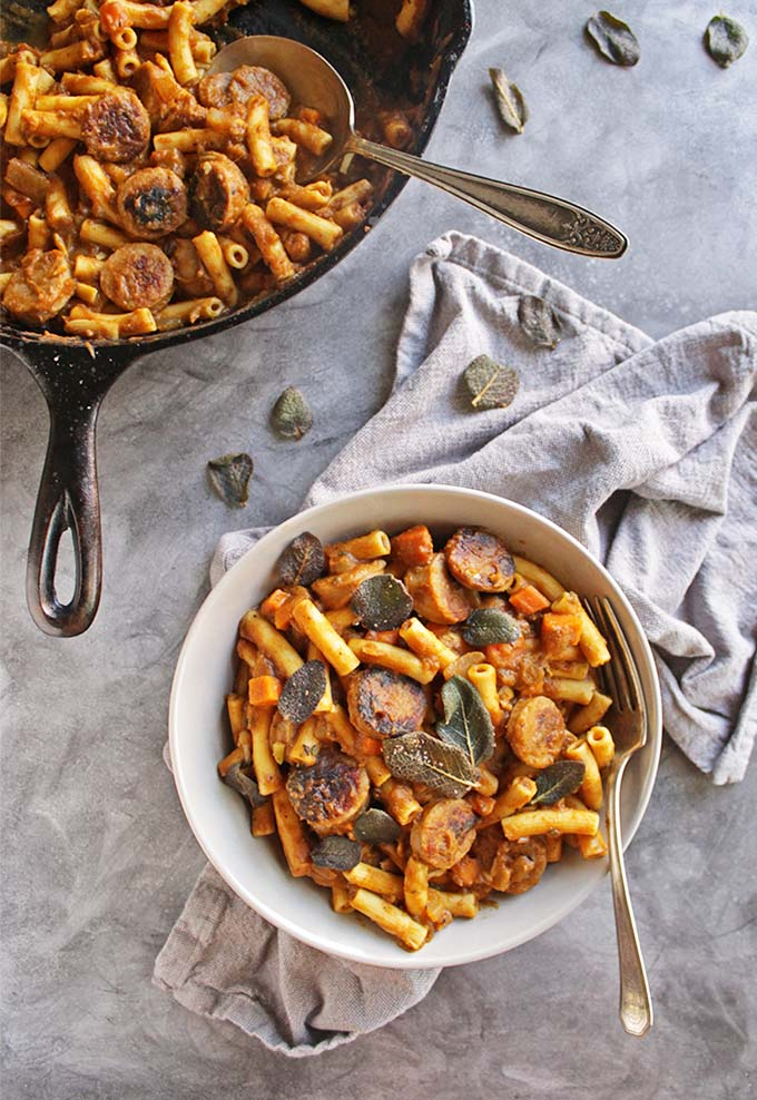 Gluten Free Pumpkin Pasta with Sausage and Crispy Fried Sage - Pumpkin pasta with a thick savory pumpkin sauce, sweet apple chicken sausage, and topped with crispy fried sage leaves. The ultimate recipe for fall comfort food! Only takes 35 minutes to make! One of our favorite fall meals. | robustrecipes.com