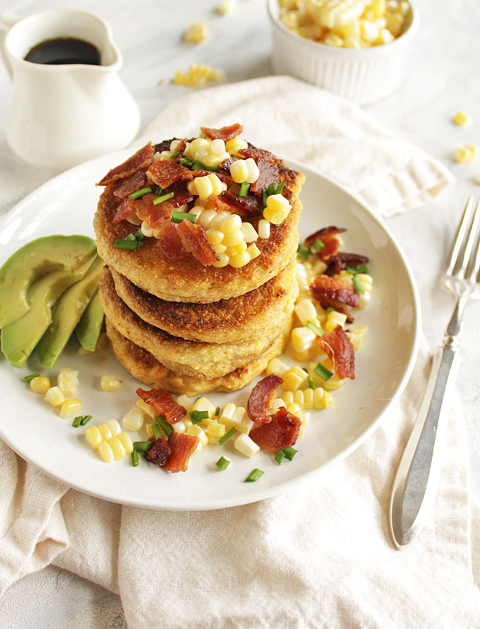 Cornmeal Pancakes with Bacon and corn (gluten free) - Savory cornmeal pancakes that are topped with crispy, salty bacon, fresh corn kernels, avocado slices, chives and a drizzle of maple syrup. These pancakes are that perfect balance of savory with a hint of sweetness. The ultimate weekend morning breakfast, especially when served along side some eggs. This recipe is dairy free adaptable and gluten free! So yum! | robustrecipes.com