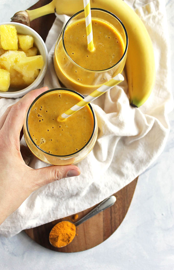 Pineapple ginger turmeric smoothie - a refreshing version of golden milk. It's sweet, tropical, ginger-y and warming from that turmeric. Plus it is packed with health benefits: aids in digestion, packed with  vitamin c, anti-inflammatory properties, and healthy fats. Great for when you are feeling sick or under the weather. So yum! (Vegan/Gluten Free/ Dairy Free) | robustrecipes.com