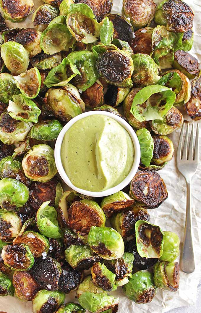 Crispy Brussels Sprouts with Basil Cashew Sauce - Crispy Brussels sprouts served with an AMAZING creamy basil cashew sauce for dipping. This recipe makes a great appetizer for parties or Thanksgiving and Christmas. So YUM!!! (Vegan/Dairy Free/Gluten Free) | robustrecipes.com