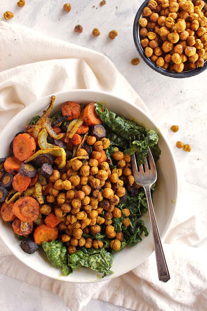 Warm Curry Salad with Crunchy Chickpeas - This salad is packed with freshly roasted veggies and crunchy chickpeas with warming curry powder and a curry tahini dressing. It's hearty, satisfying, and the perfect way to eat a ton of veggies. The perfect salad recipe for fall and winter. (Vegan & Gluten Free) | robustrecipes.com