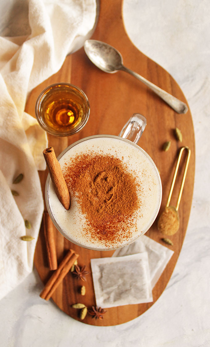 Coconut whiskey chai latte - Coconut chai latte meets whiskey. Whiskey chai latte is an indulgent cocktail that's the perfect way to cozy up and wind down during the fall or winter. So delicious with all of those chai spices: cardamom, ginger, cinnamon, and cloves. Made using a bagged chai tea, super easy recipe! This drink is vegan and dairy free with a gluten free option (swap the whiskey for spiced rum!).