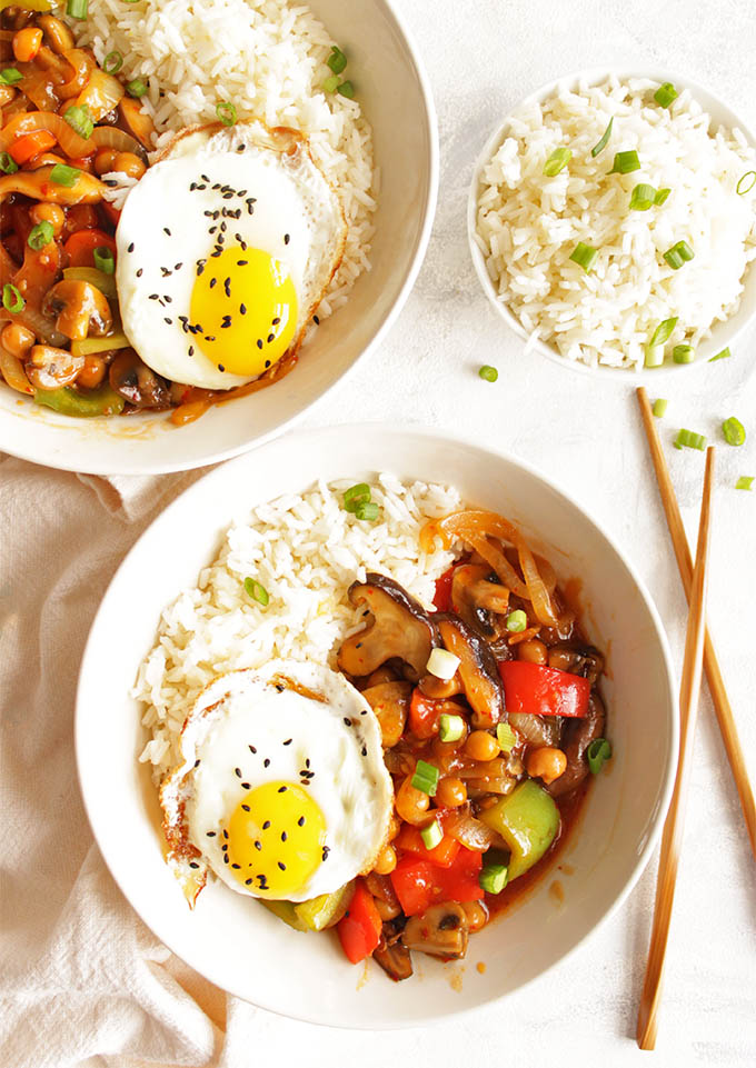 Chickpea and mushroom stir fry with fried eggs - Super veggie packed and healthy vegetarian meal that comes together in 30 minutes! That sauce + runny egg yolk is THE BEST! Perfect recipe for weeknight meals. (Gluten Free & vegetarian & dairy free) | robustrecipes.com