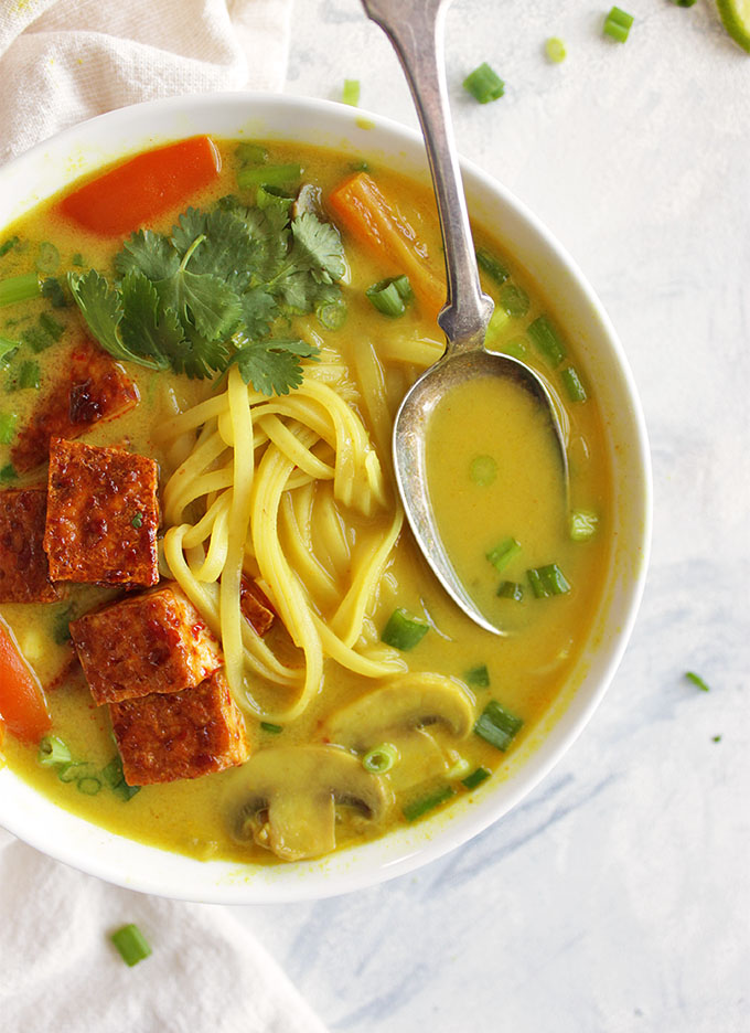 Thai curry soup, sauteed mushrooms, bell peppers, onions, and rice noddles in a creamy curry broth. And topped with crispy tofu. Only takes 30 minutes to make, the perfect weeknight dinner recipe, especially in the winter! (Vegan, Gluten Free, Vegetarian) | robustrecipes.com