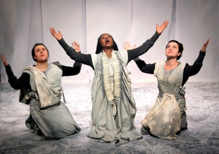 The chorus and Jocasta: Emma Tollman; Sizi Keke and Nicola Pilkington. Photograph by Ruphin Coudyzer.