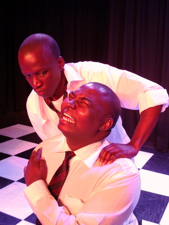 """I'll show you!"" school bully Richie (Letshabang Moshime) tortures his victim Russell (Gamelihle Bovana). Photograph courtesy National Children's Theatre."