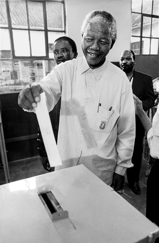 April 26, 1994 Nelson Mandela casts his vote for the very first time, an iconic photograph by Paul Weinberg.
