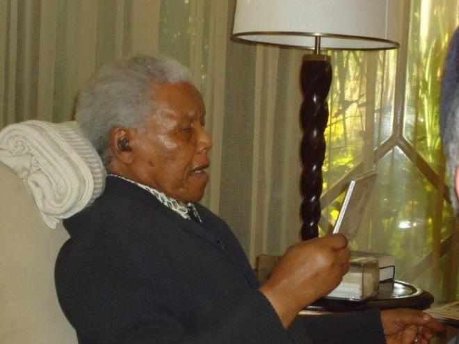 Nelson Mandela examining the CD of a composition Zaidel-Rudolph made, celebrating his life. Photograph courtesy Jeanne Zaidel-Rudolph