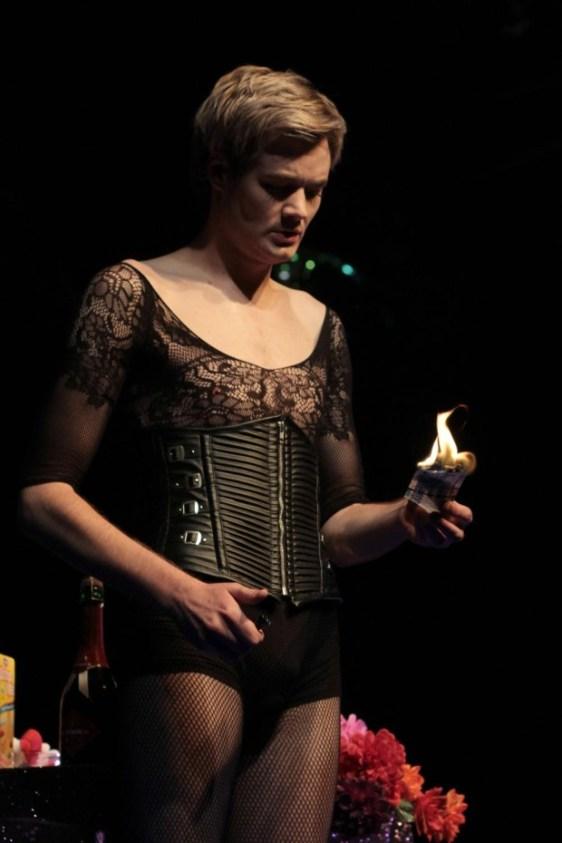 The money shot: Gavin Krastin burns some cash. Photograph by John Hogg.