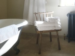 Room 3 bathroom chair and towels