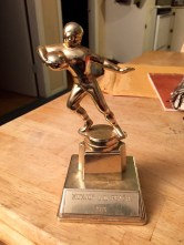 A football trophy from The Munjoy Little Peach league.