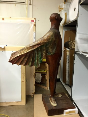 Love this winged man in art storage!