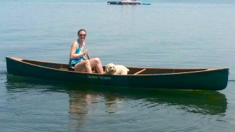 Dog in canoe. They do it all!