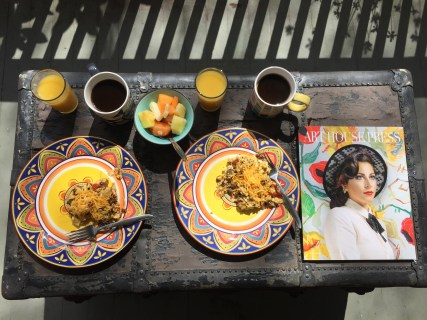 Eggs, coffe, & fruit on the porch on a lazy Saturday