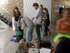 Audience members getting involved in making underwater sounds during the performance of Praying Mantis IV at the Purpur festival for transgressive arts, November 2015.
