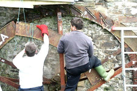 Dan and Kevin Harrison dismantling the old wheel