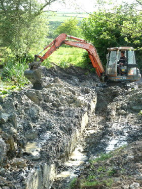 Trench in pond providing for eco friendly heating at Roch Mill and Granary self catering holiday cottage, near Solva, St Davids and Newgale, Pembrokeshire Coast National Park, South West Wales