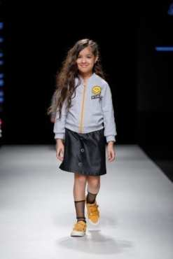 Grey unisex jacket for boys and kids and leather look skirt with black tulle socks for toddler girls