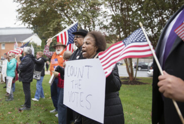 NAACP files suit over voter instructions in undecided race