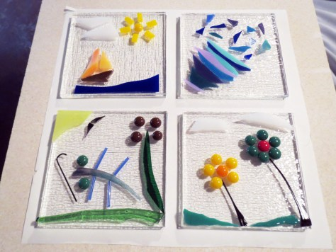 Fused glass coasters made by family members.