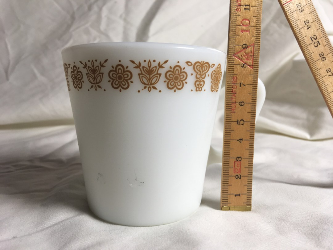 white mug with measuring stick for scale